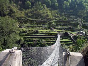 Bridge into lower Chomrong's terraced fields.