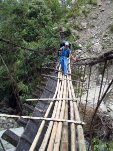 A broken bridge, repaired with bamboo logs.
